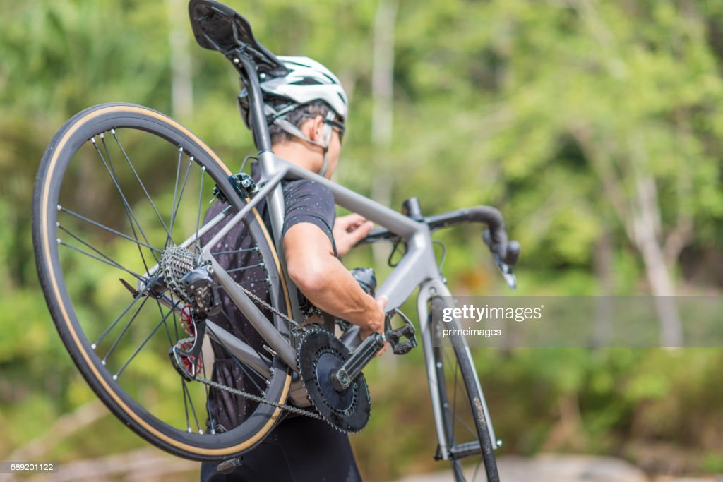 Young man Cyclist riding mountain bike in public park at moring : Stock Photo