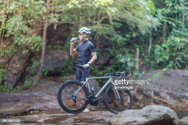Young man Cyclist riding mountain bike in public park at moring