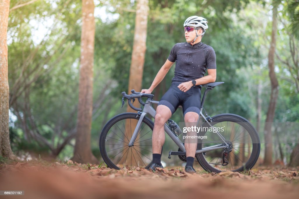 Young man Cyclist riding mountain bike on trail at moring : Stock Photo