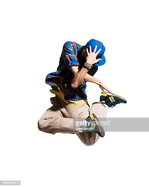 young man dancer makes jump - breakdancing stock photos and pictures