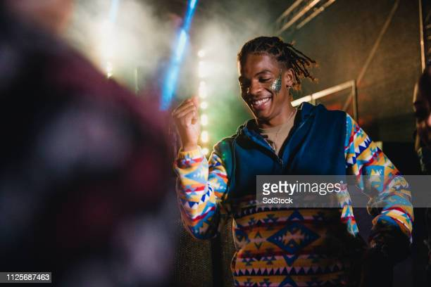 young man dancing at a festival - festival goer stock pictures, royalty-free photos & images
