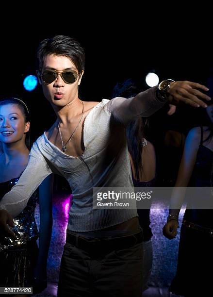 Young Man Dancing at Nightclub