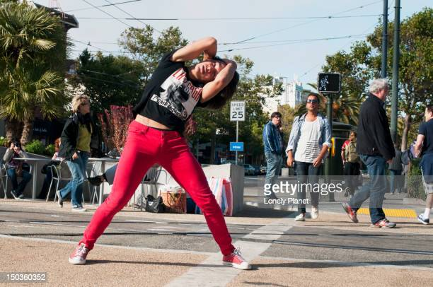 young man dancing in tight red pants in harvey milk plaza. - man in tight pants stock photos and pictures