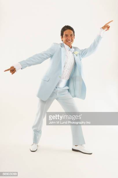 Young man dancing in tuxedo