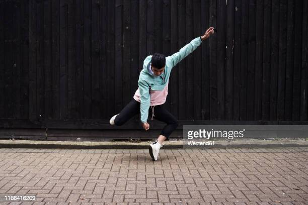 young man dancing on the street - dancing stock pictures, royalty-free photos & images