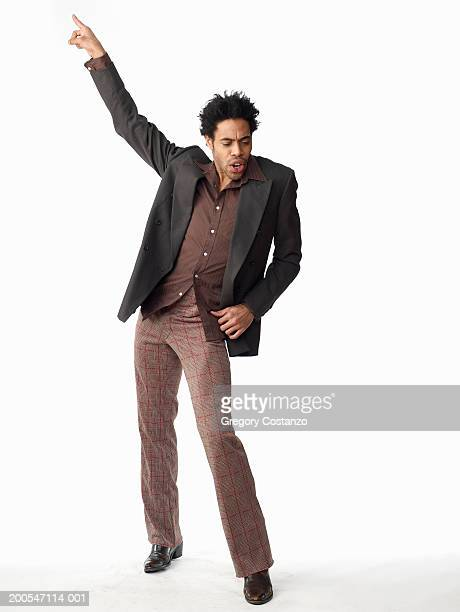 Young man dancing, on white background