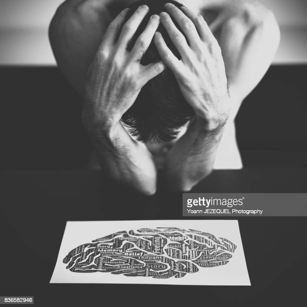 young man depressed patient takes his head in his hands - paris fury stock pictures, royalty-free photos & images