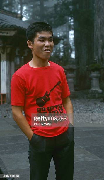 A young man displays a red Tshirt promoting a favorite rockandroll band The Beatles Japan 1966