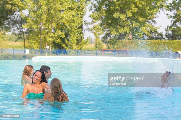 young man dives on swimming pool - pjphoto69 stock pictures, royalty-free photos & images
