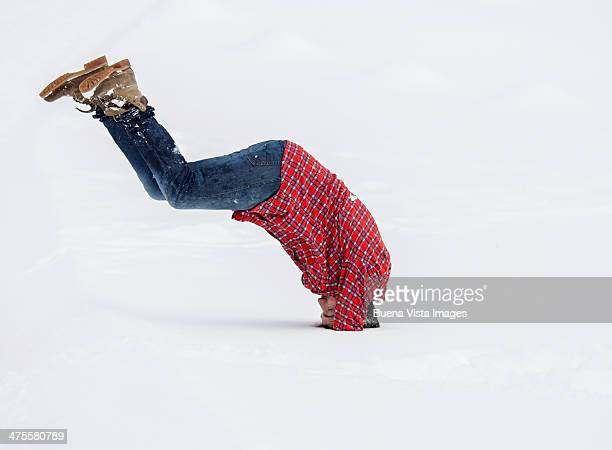 Young man diving in snow