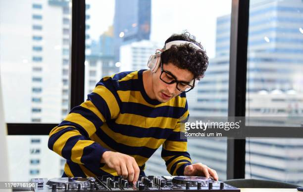 young man dj playing music - dj stock pictures, royalty-free photos & images