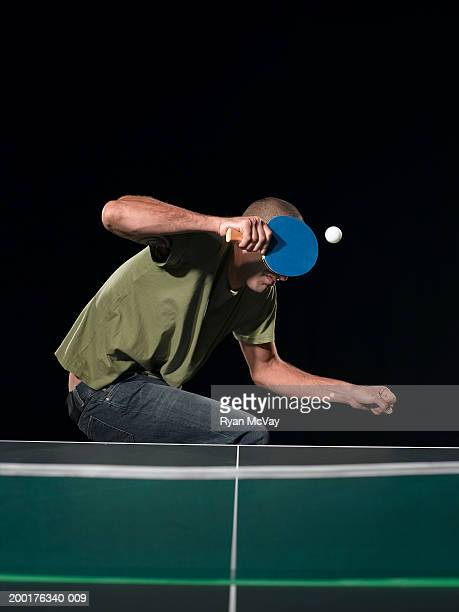 Young man dodging table tennis ball