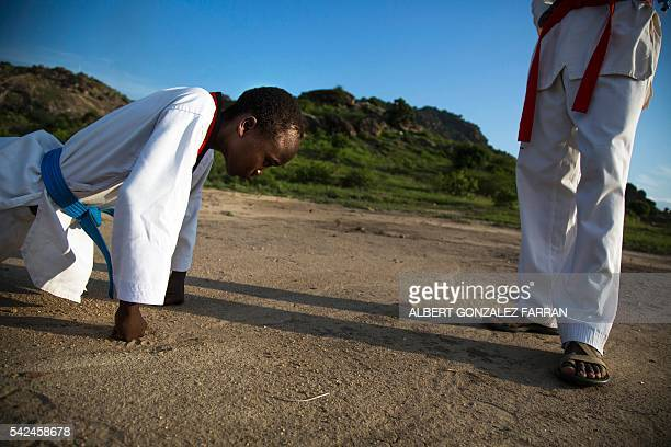 Young man does push ups during his daily taekwondo training session at the Juba Jebel on June 23, 2016. The South Sudan Tae-kwon-do Federation,...