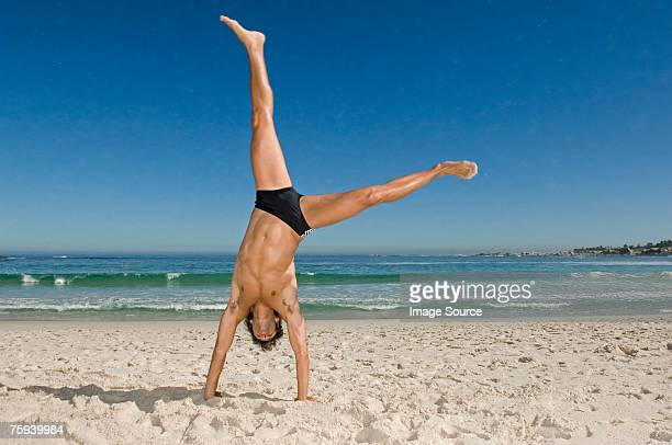 young man doing a cartwheel - cartwheel stock pictures, royalty-free photos & images