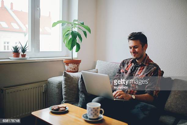 Young man doing a freelance job from home