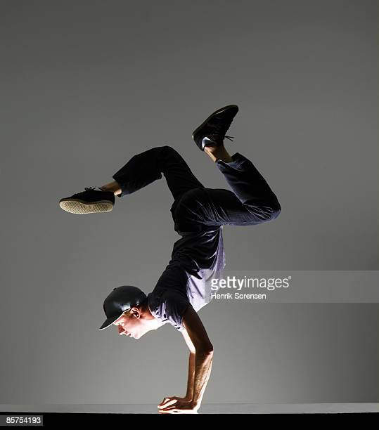 young man doing a handstand - one man only stock pictures, royalty-free photos & images
