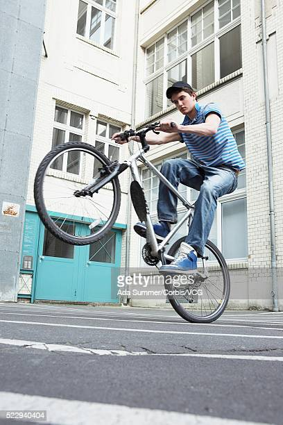 Young man doing a wheelie