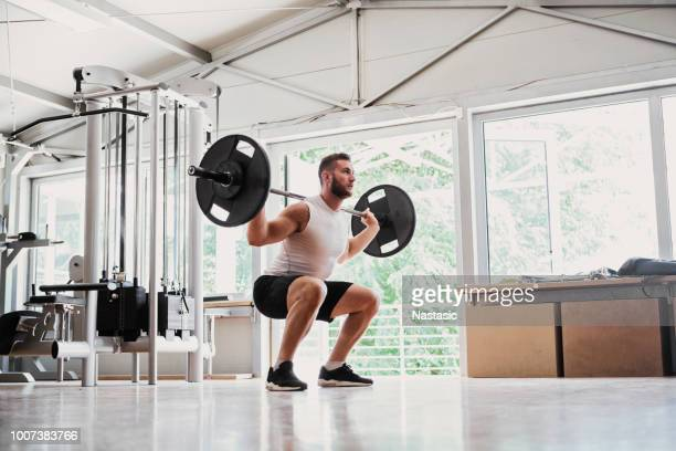 Young man doing Dead lifts