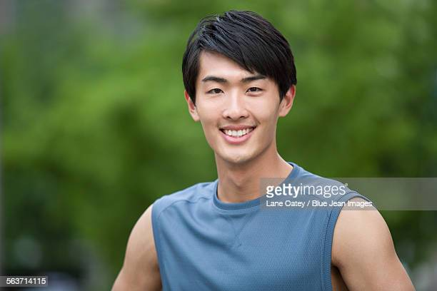 Young man doing exercise outside
