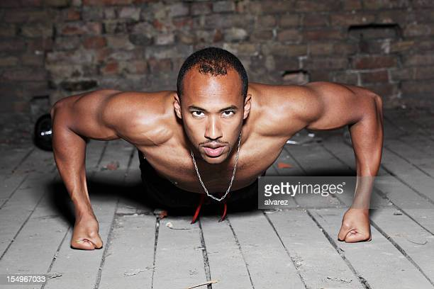 young man doing pushups - black male bodybuilders stock photos and pictures