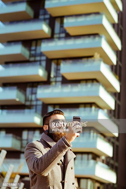 young man (hipster style) doing selfie - pjphoto69 stock pictures, royalty-free photos & images