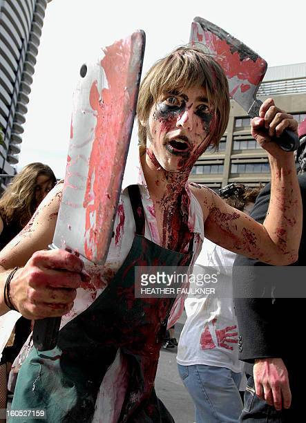 A young man dressed as a zombie brandishes toy meat cleavers in downtown Brisbane in the Australian state of Queensland 01 April 2007 during the...