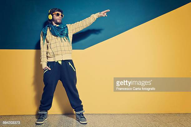 young man dressed in clothing rap - hip hop music stock pictures, royalty-free photos & images