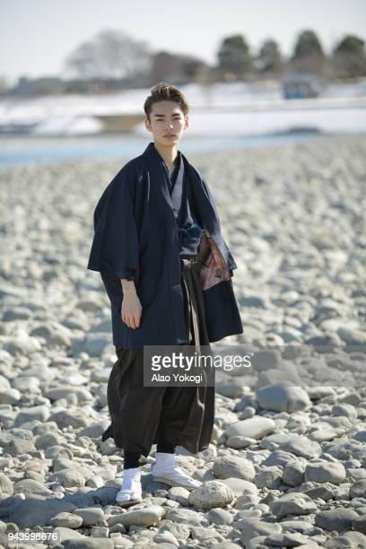 a young man dressing up and standing in a riverbank - seijin no hi fotografías e imágenes de stock