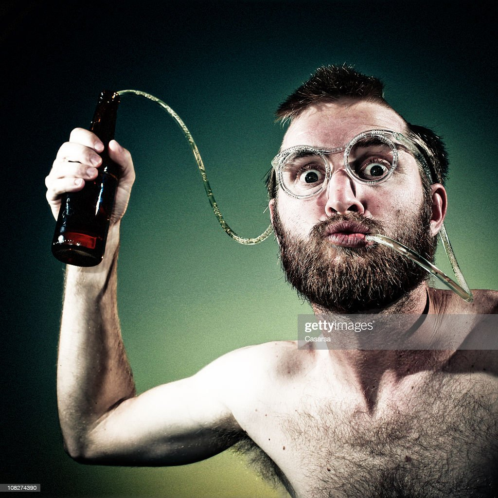Young Man Drinking Beer Out of Crazy Straw Glasses : Stock Photo
