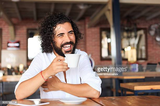 Young man drinking coffee at bar