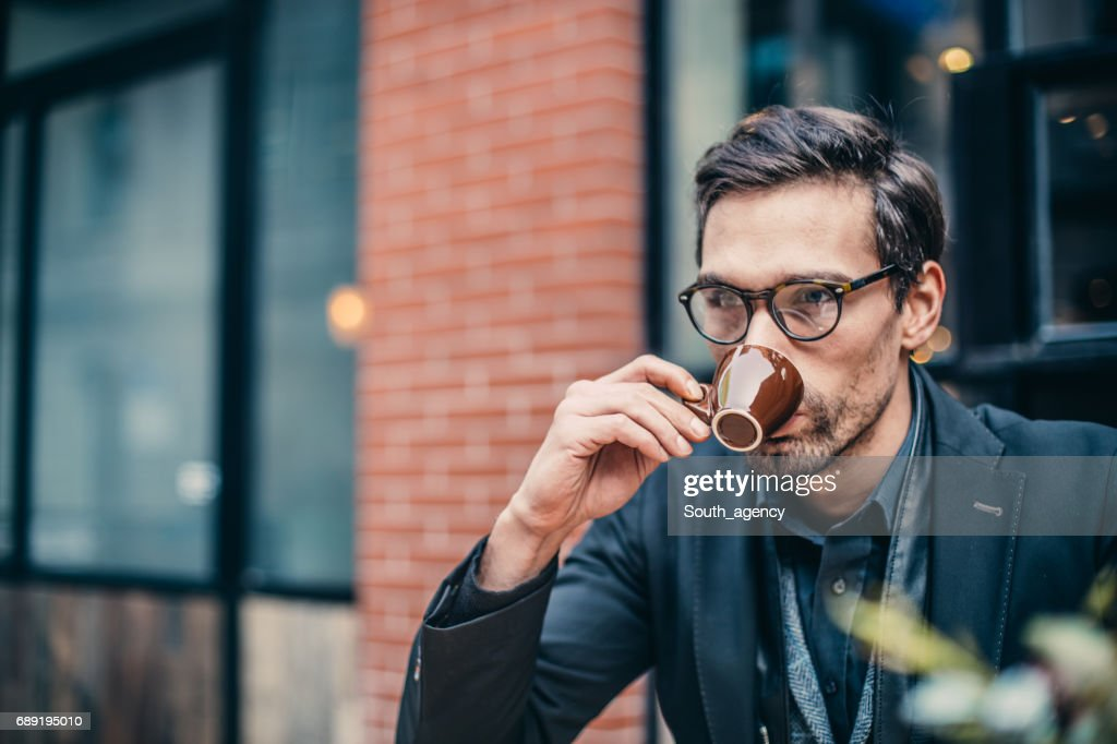Young man drinking coffee : Stock Photo