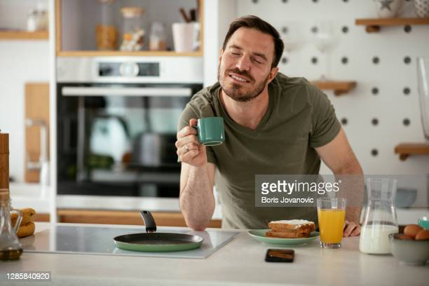 handsome man preparing breakfast at home