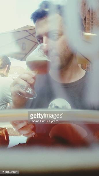 Young man drinking craft beer
