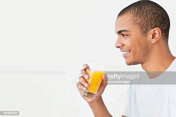 Young Man Drinking Orange Juice