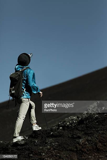 young man drinking water in the mountain