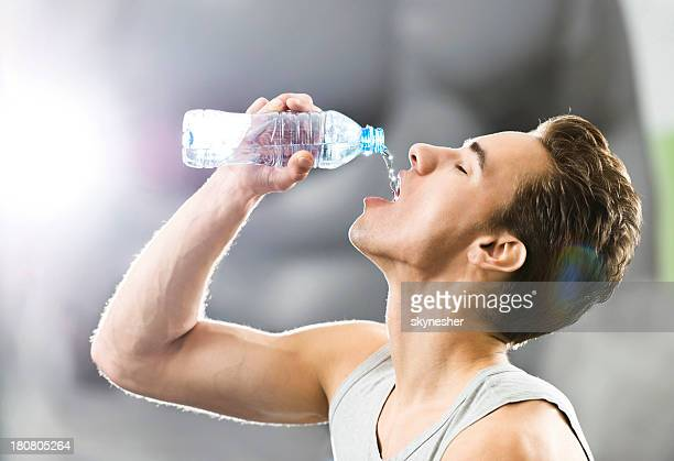 young man drinking water. - thirsty stock pictures, royalty-free photos & images
