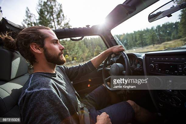 young man driving jeep on road trip, lake tahoe, nevada, usa - 4x4 stock pictures, royalty-free photos & images