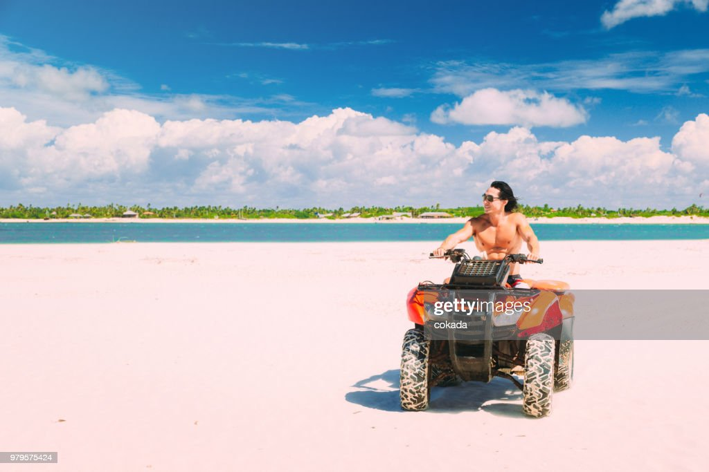 Young man driving off road ATV : Stock Photo