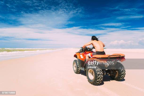Young man driving off road ATV