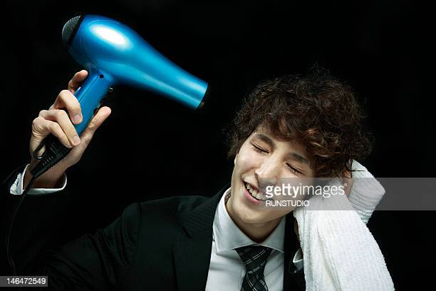young man drying hair