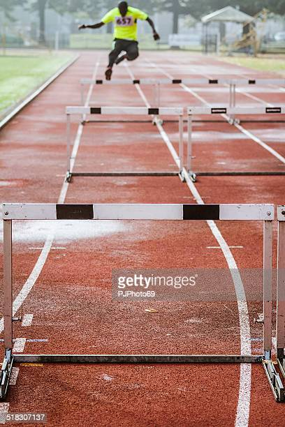 young man during training in hurdle race - pjphoto69 stock pictures, royalty-free photos & images