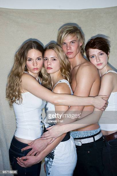 Young man embraced with three young women