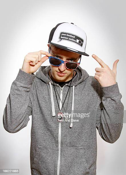 young man embraces hip hop / gangsta culture - hip hop stock pictures, royalty-free photos & images