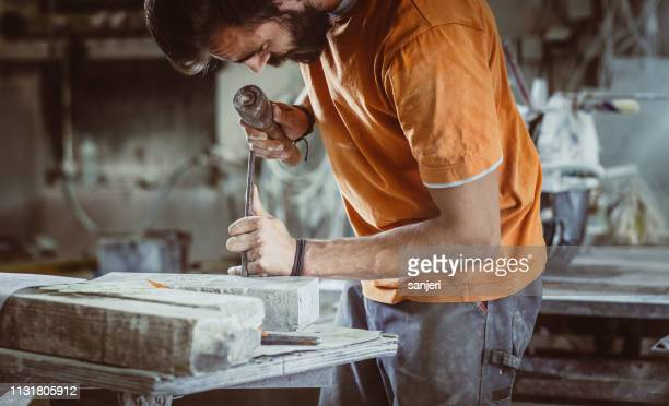 young man engraving stone - engraving stock pictures, royalty-free photos & images