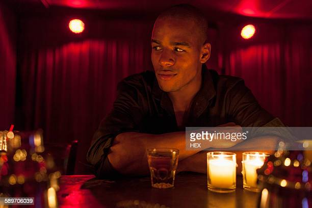 Young man enjoying a drink at a bar