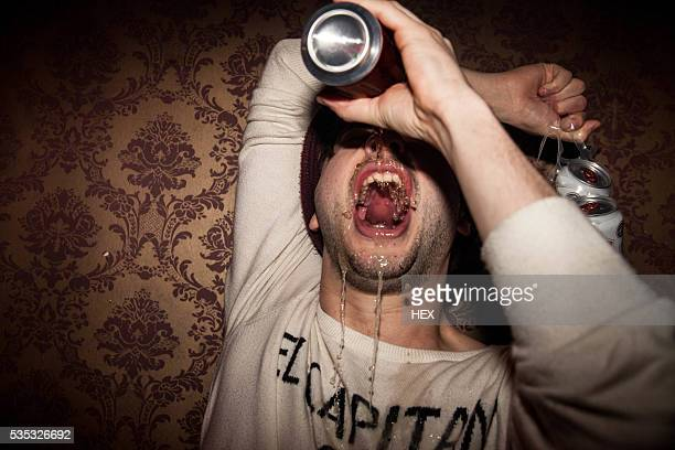 young man enjoying a night out - binge drinking stock photos and pictures