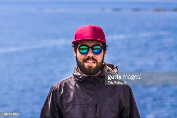 Young man enjoying a sunny day in the archipelago of Gothenburg, Sweden, Scandinavia, Europe