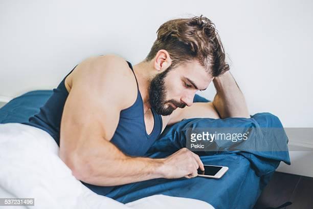Young man enjoying at home