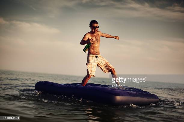 Young Man Enjoying Beach Party