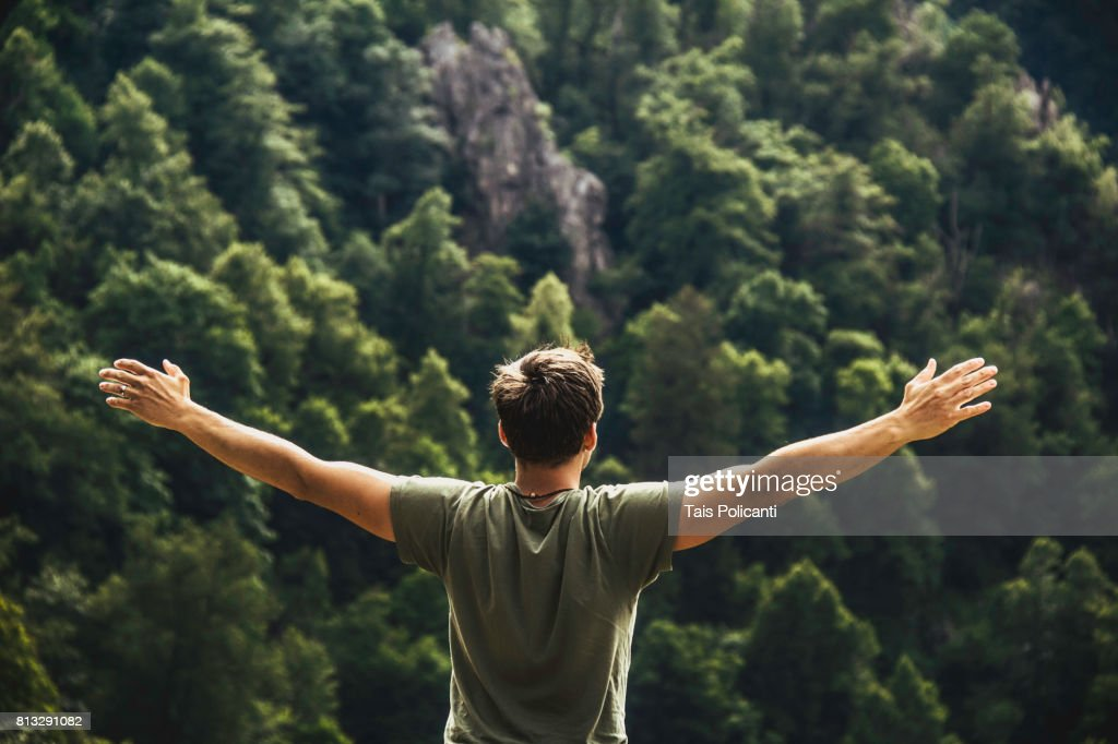 A young man enjoying freedom after hiking at the Bodetal valley in Thale - Harz mountains, Thale, Saxony-Anhalt, Germany : Stock-Foto